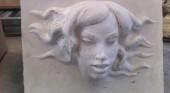 Vasca con scultura